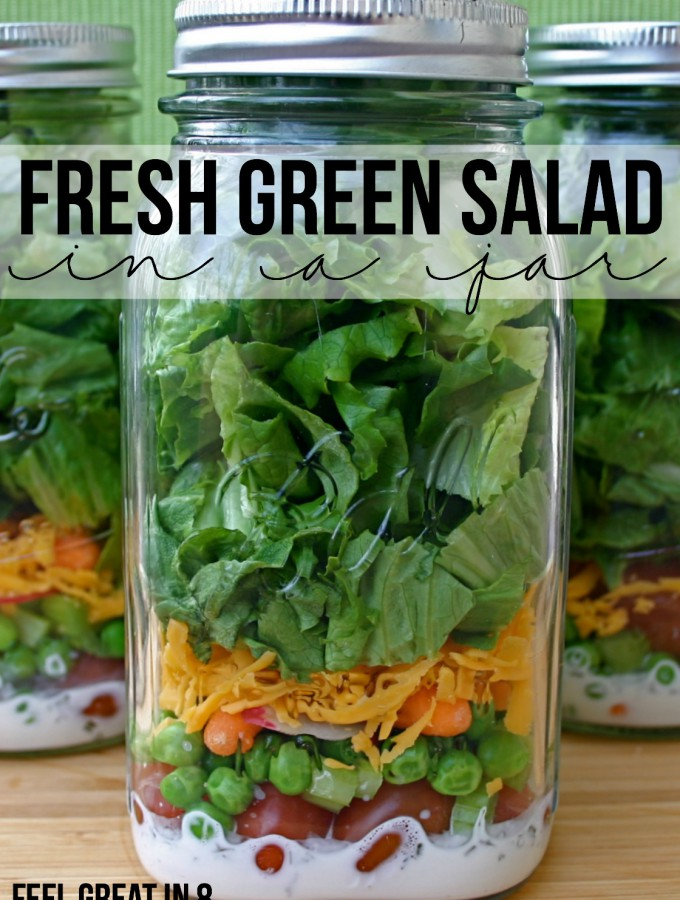 A Fresh Green Salad in a Jar is the perfect healthy solution when you are short on time! Make then on the weekend and they'll be fresh and ready all week! | Feel Great in 8 #healthy #lunch #salad