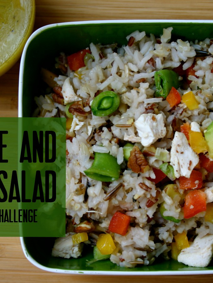 This wild rice salad with chicken, pecans, avocado, peppers, and a delicious dijon vinaigrette is absolutely delicious served warm or cold! #dinner #chicken #salad #healthy
