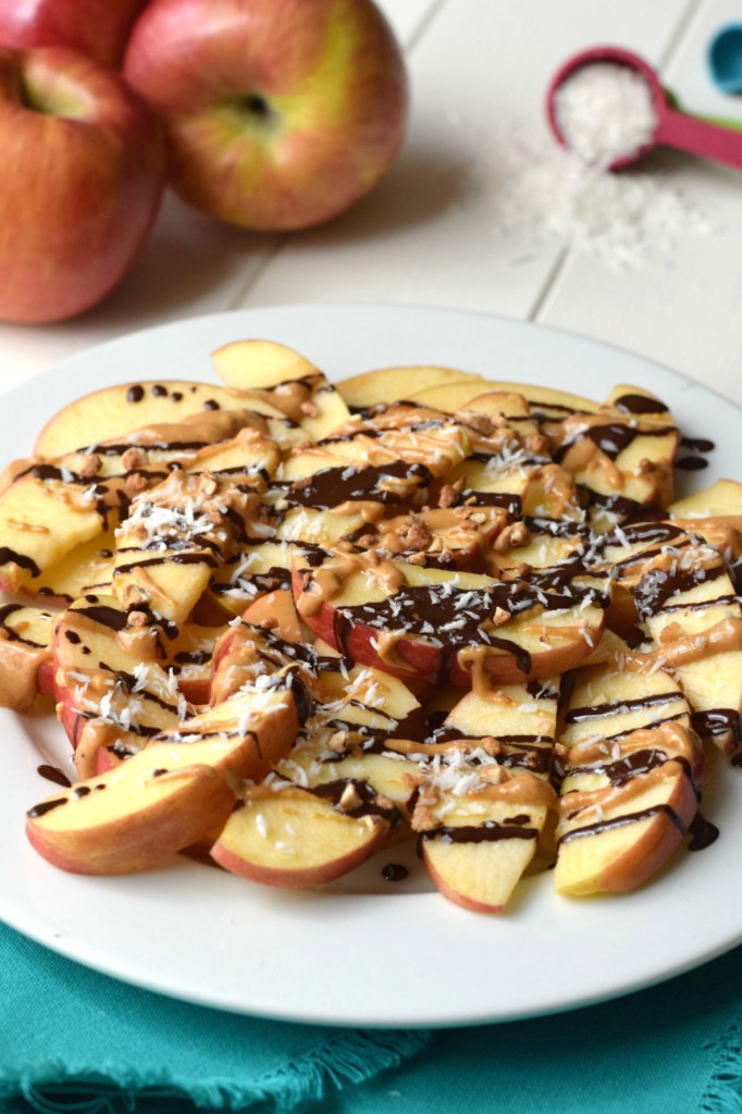 You won't believe these quick & easy Dark Chocolate Peanut Butter Apples are a healthy snack or dessert! Apples, dark chocolate, peanut butter, coconut, and almonds are the perfect flavor combo!
